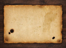 Old paper on wood texture Stock Photos