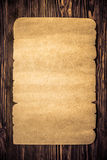 Old paper on wood texture Stock Image