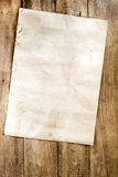 Old paper on wood texture. Empty old paper on wood texture - vintage background stock images