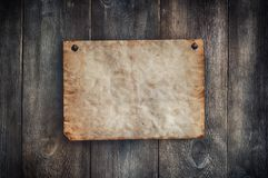 Old paper on the wood vintage background. Old paper on the wood vintage background with natural patterns royalty free stock image