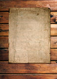 Old paper on wood wall Stock Photo