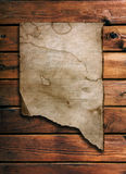 Old paper on wood wall Royalty Free Stock Images