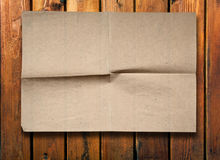 Old paper on wood wall Royalty Free Stock Photography