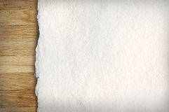 Old paper on wood. Old white paper on wooden background Royalty Free Stock Photography
