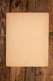 Old paper on wooden background. Old paper on an old wooden background Royalty Free Stock Images