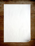 Old paper on wooden background Stock Photos