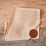 Old paper. On old wooden background stock images