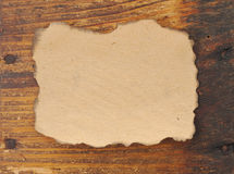 Old paper on wooden board Royalty Free Stock Photo