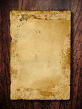 Old paper on wooden board Royalty Free Stock Photos