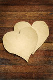 Old paper with wooden heart sign Stock Image