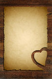 Old paper with wooden heart sign Royalty Free Stock Photo