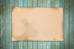 Old paper on wooden. For your text royalty free stock photography