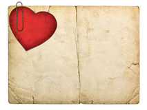 Old paperboard card with red paper heart. Isolated on white background Stock Image