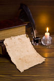 Old papers and books. On a wooden table Royalty Free Stock Images