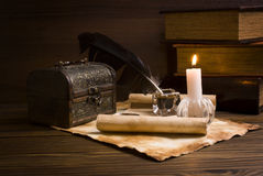 Old papers and books on a wooden table Royalty Free Stock Photo