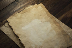 Old papers, brown wood texture Royalty Free Stock Photo