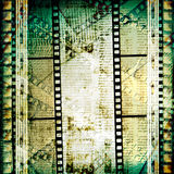 Old papers and grunge  filmstrip. On the alienated background Stock Photography