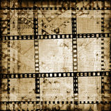 Old papers and grunge  filmstrip. On the alienated background Royalty Free Stock Photo