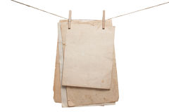Old papers hanging on the rope with clothespins Royalty Free Stock Photo