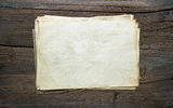 Old papers on wooden background Royalty Free Stock Image