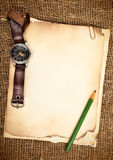 Old papers and wristwatch Royalty Free Stock Photography