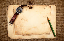 Old papers and wristwatch. Still-life with old blank papers and wristwatch Royalty Free Stock Image