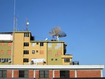 Old parabolic antennas. Old type parabolic antennas installed on a residential building. They were used for satellite TV Royalty Free Stock Photography