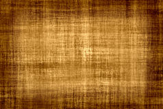 Old parchment. Old vignetted parchment paper background Stock Images