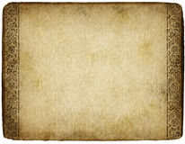 Old parchment. Old grunge and marked parchment with ornamental design Royalty Free Stock Images