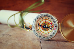 Old parchment and antique compass on wooden table Stock Photography