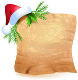 Old parchment and Christmas hat Stock Images