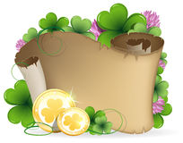 Old parchment, clover and gold coins Royalty Free Stock Photos