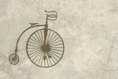 Old parchment with old fashioned bicycle. Vintage looking parchment background with old bicycle imprints and copy space stock illustration