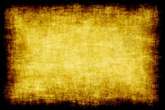 Old parchment paper. A sheet of old textured parchment paper with dark weathered edges Stock Photography