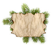 Old parchment paper with copy space on Christmas tree branch bac Stock Image