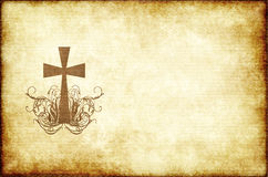 Old parchment paper with cross. Christian cross on old and worn parchment paper stock photos