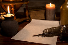Old parchment paper with a quill and ink, medieval theme Royalty Free Stock Photo