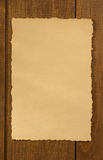 Old parchment at wood Royalty Free Stock Photography