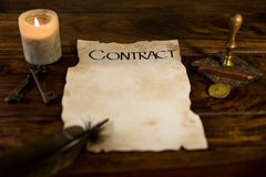 Old parchment with the word Contract stock photo