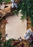 Old parchment for your wishes. On a wooden background royalty free stock photos
