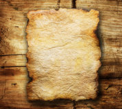 Old Parer. Old Paper sheet over wooden background Royalty Free Stock Images