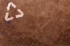 Old parer background with recycle sign. Old brown parer background with recycle sign Stock Images