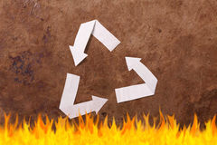 Old parer background with recycle sign. Old brown parer background with recycle sign Stock Photo