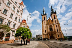 Old parish church and tramlines in old city. PRAGUE: Old parish church of St. Anthony of Padua in Holesovice area and tramlines under the sun in Czech Republic Royalty Free Stock Photo