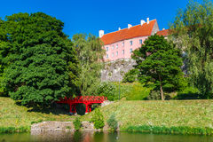 Old park with pond and view of Toompea hill, Tallinn Stock Photos