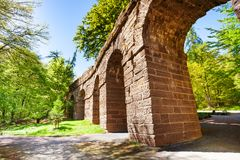 Old part of aqueduct in Bergpark near Kassel. Ruins of old aqueduct in Bergpark Wilhelmshohe near Kassel Germany Europe at spring Royalty Free Stock Image