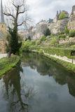Old part of Luxembourg in spring time. Old part of Luxembourg during spring time with tree reflecting in water Stock Photography