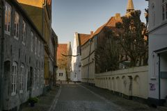 Old part of town with a cobblestone road Stock Photos