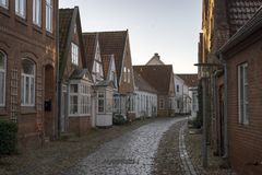 Old part of town with a cobblestone road Stock Photography