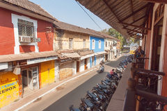 Old part of town with small buildings and the cozy old style cafe with balconies Royalty Free Stock Images